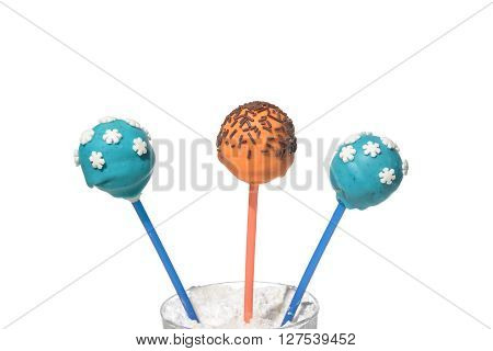 Three delicious colored cakepops on isolated background