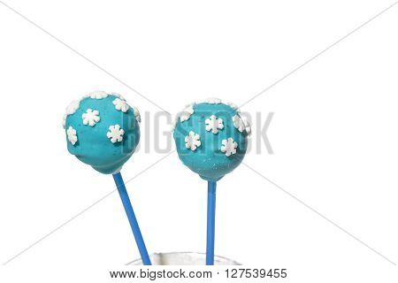 Two blue cakepops with snowflakes decorations on isolated background