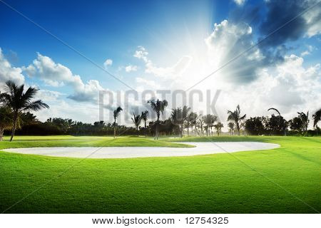 sunset on golf field