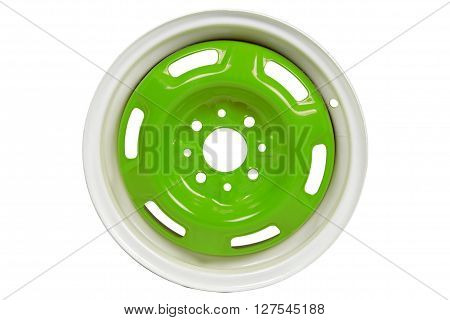 Powder coating of green wheel disk on white background