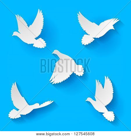 Five silhouette white doves fly in blue sky
