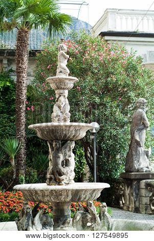 Varenna Italy - September 4th 2015: closeup of a fountain in the botanical garden at Villa Monastero in Varenna Italy.