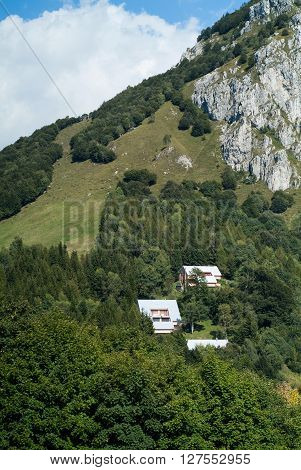 three houses photographed at Piani d'Erna (part of the Alps) near Lake Como in Italy