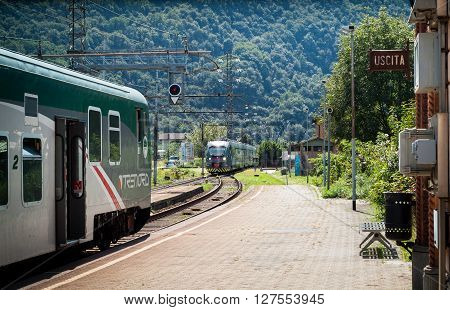 Colico Italy - September 8th 2015: a Trenord train approaching a platform in Colico a town in the northern part of Lake Como