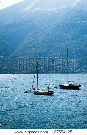 two white boats photographed at Lake Como in North Italy