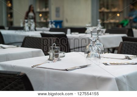 Lecco Italy - September 8th 2015: wine glasses beautifully arranged on a white table at a restaurant in Lecco an Italian town near Lake Como.