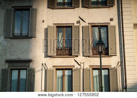 an atmospheric photo of a traditional Italian facade in Bergamo Alta