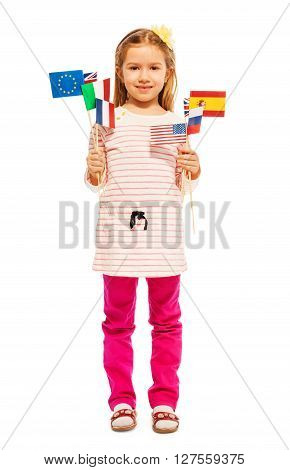 Whole-length portrait of beautiful girl holding flags of European nations and USA in her hands, isolated on white