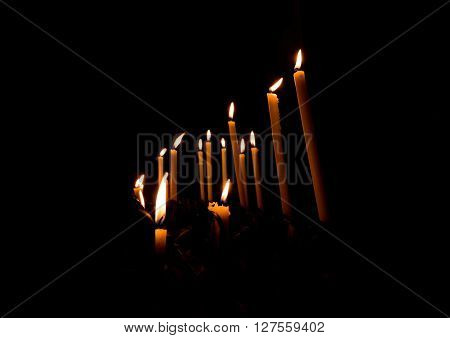 Candles in Christian church in Venice, Italy