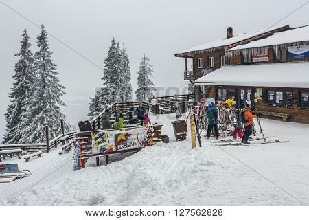 Skiers At Postavaru Chalet