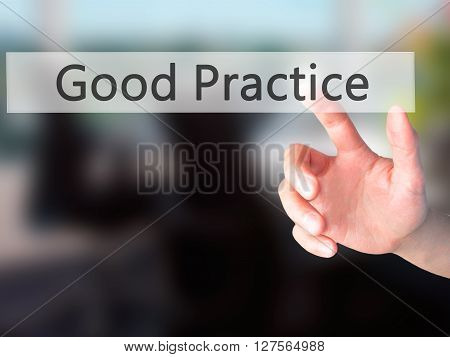 Good Practice - Hand Pressing A Button On Blurred Background Concept On Visual Screen.