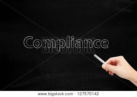 Compliance written with chalk