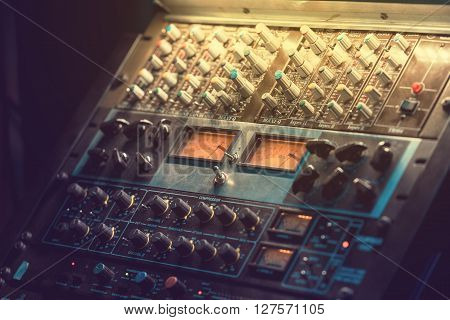 Sound recording equipment. Music mixer controls. Soft photo