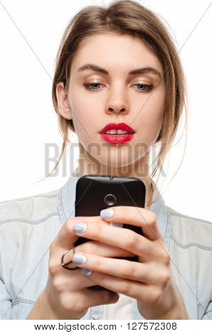 beautiful young woman chatting sms or serfing the internet by mobile phone on a white background poster