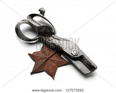 Retro metal scissors and six-pointed star at white