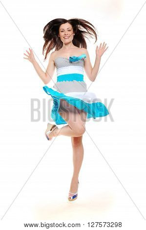 Beautiful excited jumping girl in summer dress