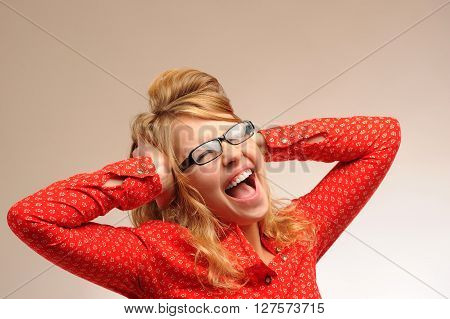 Screaming pretty blonde girl with open mouth