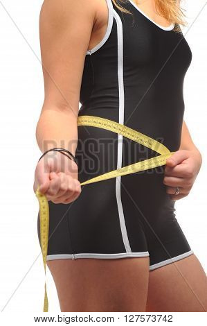 Girl body with measuring tape at white background