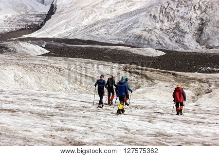 Group of Mountain Climbers with High Altitude Boots and Clothing Crossing Ice Section During Ascent of Alpine Expedition in Asia Mountain Area poster