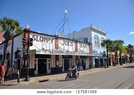 KEY WEST, FL, USA - DEC 20: Sloppy Joe's Bar on Duval Street on December 20th, 2015 in Key West, Florida, USA. Sloppy Joe's Bar is a historic bar in Key West and was Ernest Hemingway's favorite. ** Note: Visible grain at 100%, best at smaller sizes