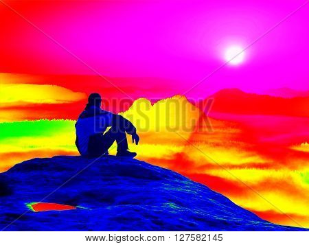 Infrared scan of rocky landscape, pine forest with colorful fog, hot sunny sky above. Grunge background in amazing thermography colors.