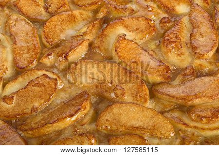Cake with pieces of apple surface view as a food background focus stacking.