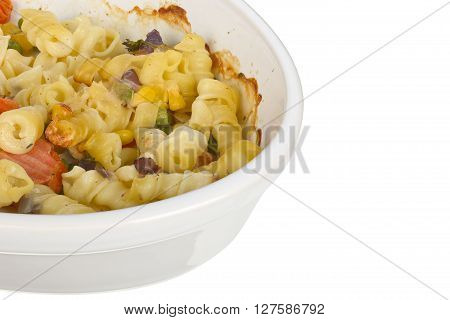 Pasta with cheese gratain in an oval dish isolated on white background  focus stacking.
