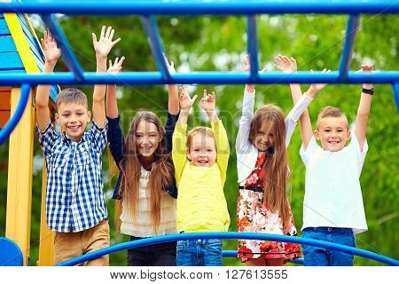 happy excited kids having fun together on playground
