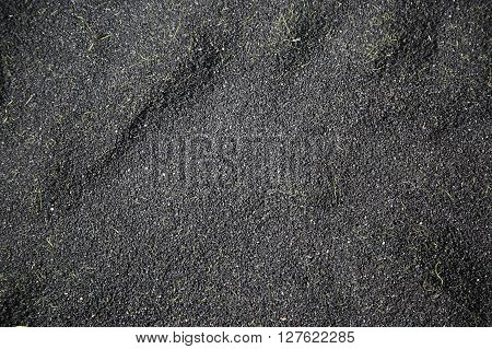 Texture of black rubber crumb for soccer filed