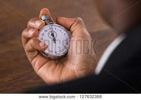 Businessperson Holding Stop Watch