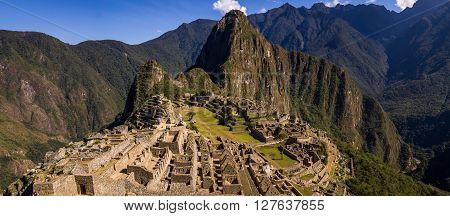Machu Picchu, PERU in October 2015: Where the Incas used to live nowadays thousands of tourists come to see the Inca heritage. Machu Picchu is in a picturesque setting in the Peruvian Andes.