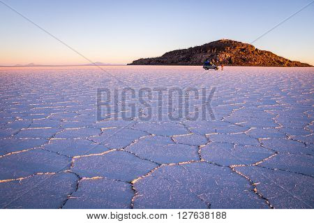 Salar Uyuni, BOLIVIA in September 2015: The sun rises over worlds largest salt lake Salar de Uyuni. Southwestern Bolivia is well-known for dramatic landscapes, lagunas, geysers and deserts.