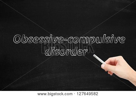 Obsessive compulsive disorder written on a blackboard
