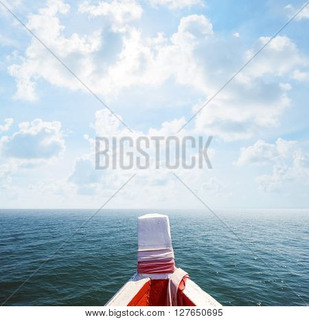 Floating boat on beautiful ocean and blue sky