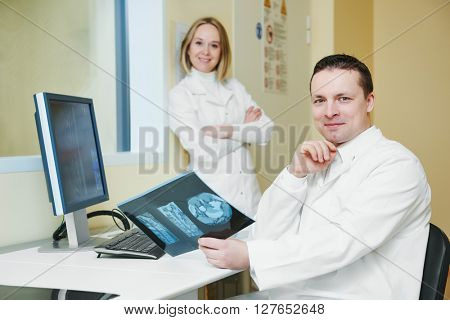 computed tomography or MRI scanner test analysis workers