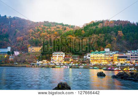 YAMANASHI, JAPAN - NOVEMBER 22: Kawaguchiko in Yamanashi, Japan on November 22, 2015. Hotels and resorts are surrounded lake kawaguchi ,Yamanashi Prefecture, Japan