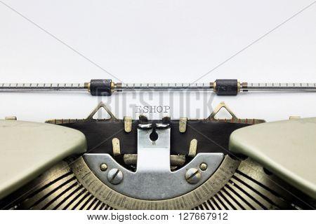 Close-up of word Eshop on typewriter sheet