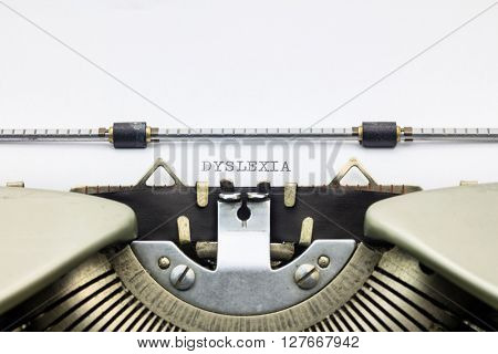 Close-up of word Dyslexia on typewriter sheet