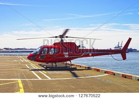 Red Helicopter On Helipad In Lower Manhattan In New York