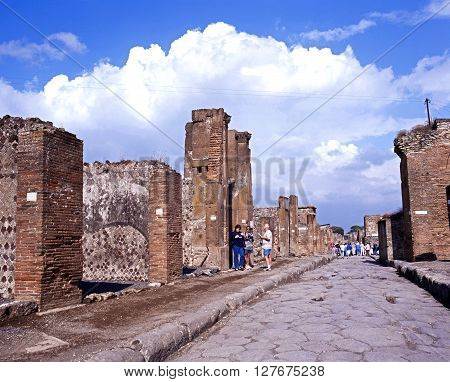 POMPEII, ITALY - SEPTEMBER 21, 1996 - Tourists walking along the Via dell Abbondanza Pompeii Campania Italy Europe, September 21, 1996.
