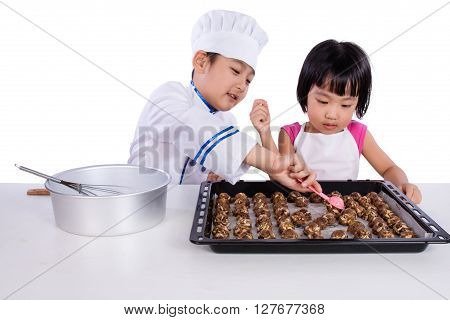 Asian Chinese Kid Baking Cookies