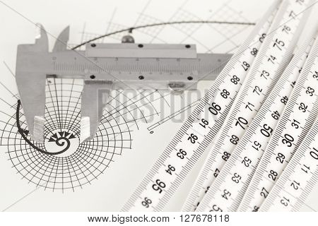 drawing of the golden section, folding ruler & calipers