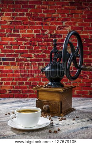 coffee grinder on the background of brick wall