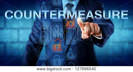 Enterprise manager is touching COUNTERMEASURE on an interactive visual screen. Information technology metaphor and computer security concept for actions aimed at reducing vulnerabilities or attacks.