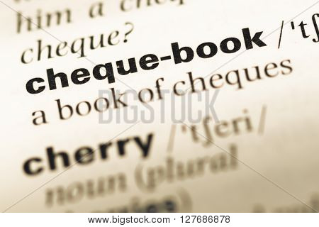 Close Up Of Old English Dictionary Page With Word Cheque Book.
