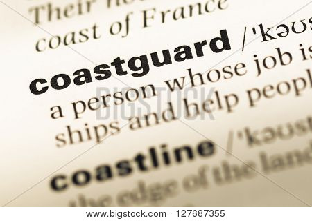 Close Up Of Old English Dictionary Page With Word Coastguard.