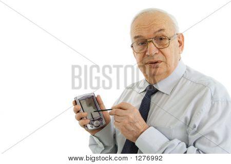 Successful Businessman Working On A Pda Organizer