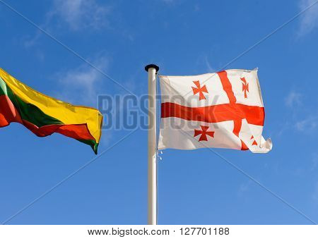 flags of Georgia and Lithuania on the background of the sky