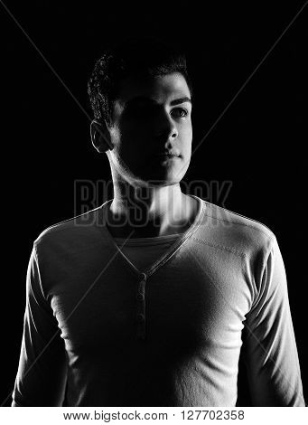 stylish bw young man portrait in low-key