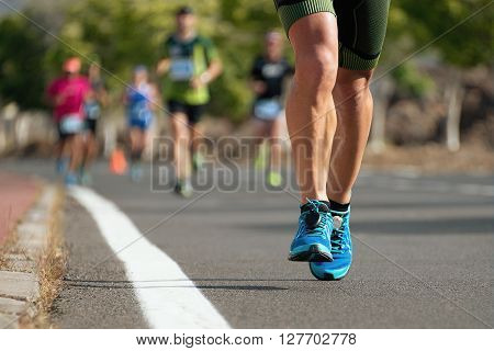 Marathon running race, runners feet on road, sport, fitness and healthy lifestyle concept